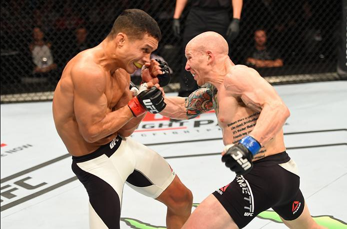 ROTTERDAM, NETHERLANDS - MAY 08:  (R-L) Josh Emmett punches Jon Tuck in their lightweight bout during the UFC Fight Night event at Ahoy Rotterdam on May 8, 2016 in Rotterdam, Netherlands. (Photo by Josh Hedges/Zuffa LLC/Zuffa LLC via Getty Images)