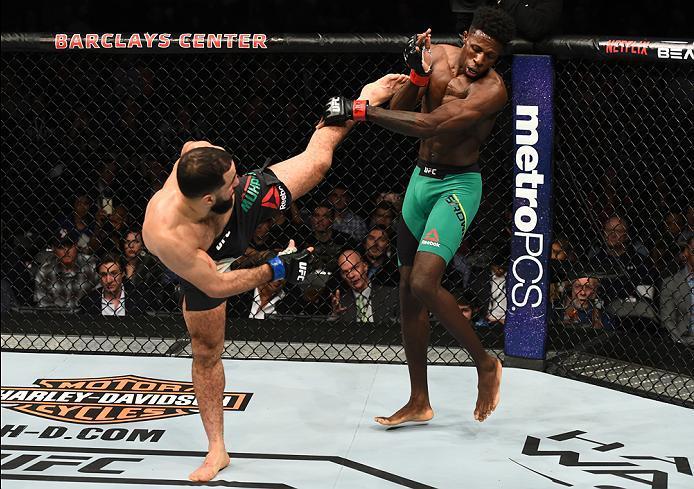 BROOKLYN, NEW YORK - FEBRUARY 11:  (L-R) Belal Muhammad kicks Randy Brown of Jamaica in their welterweight bout during the UFC 208 event inside Barclays Center on February 11, 2017 in Brooklyn, New York. (Photo by Jeff Bottari/Zuffa LLC/Zuffa LLC via Gett