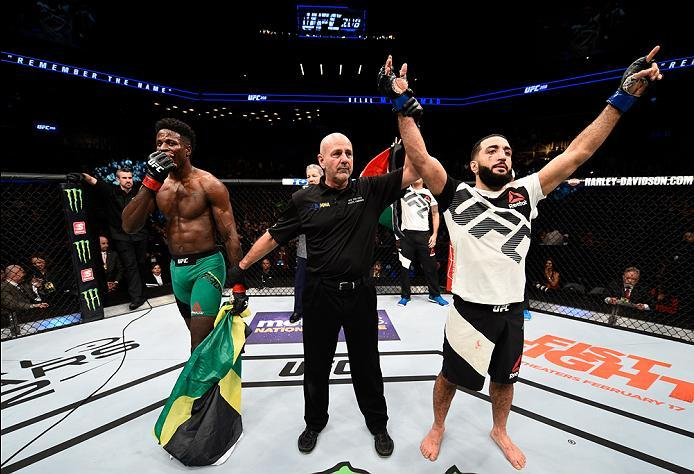 BROOKLYN, NEW YORK - FEBRUARY 11:  (L-R) Belal Muhammad celebrates his victory over Randy Brown of Jamaica in their welterweight bout during the UFC 208 event inside Barclays Center on February 11, 2017 in Brooklyn, New York. (Photo by Jeff Bottari/Zuffa
