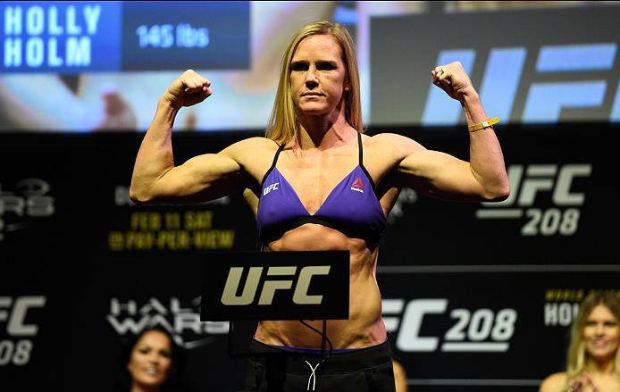 BROOKLYN, NEW YORK - FEBRUARY 10:  Holly Holm poses on the scale during the UFC 208 weigh-in inside Kings Theater on February 10, 2017 in Brooklyn, New York. (Photo by Jeff Bottari/Zuffa LLC/Zuffa LLC via Getty Images)