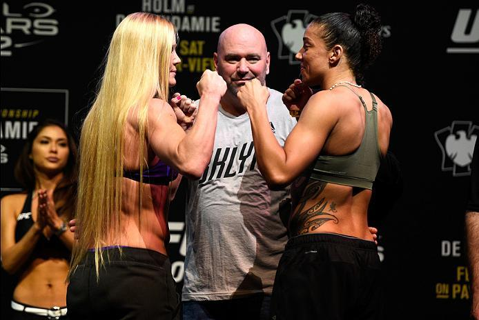 BROOKLYN, NEW YORK - FEBRUARY 10:  (L-R) Holly Holm and Germaine de Randamie of The Netherlands face off during the UFC 208 weigh-in inside Kings Theater on February 10, 2017 in Brooklyn, New York. (Photo by Jeff Bottari/Zuffa LLC/Zuffa LLC via Getty Imag