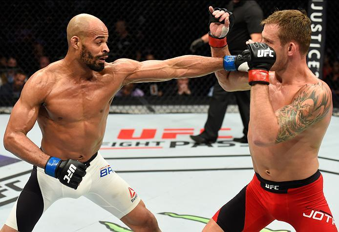 DALLAS, TX - MAY 13:  (L-R) David Branch punches Krzysztof Jotko in their middleweight fight during the UFC 211 event at the American Airlines Center on May 13, 2017 in Dallas, Texas. (Photo by Josh Hedges/Zuffa LLC/Zuffa LLC via Getty Images)