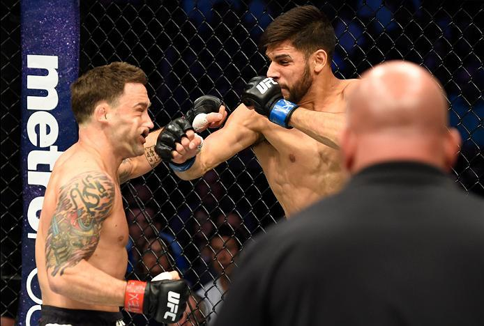 DALLAS, TX - MAY 13:  (R-L) Yair Rodriguez punches Frankie Edgar in their featherweight fight during the UFC 211 event at the American Airlines Center on May 13, 2017 in Dallas, Texas. (Photo by Josh Hedges/Zuffa LLC/Zuffa LLC via Getty Images)
