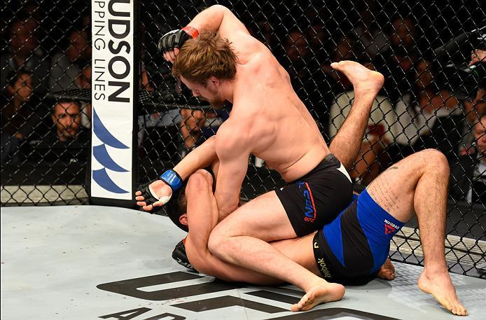 LONDON, ENGLAND - MARCH 18:  Gunnar Nelson of Iceland (top) punches Alan Jouban of the United States in their welterweight fight during the UFC Fight Night event at The O2 arena on March 18, 2017 in London, England. (Photo by Josh Hedges/Zuffa LLC/Zuffa L