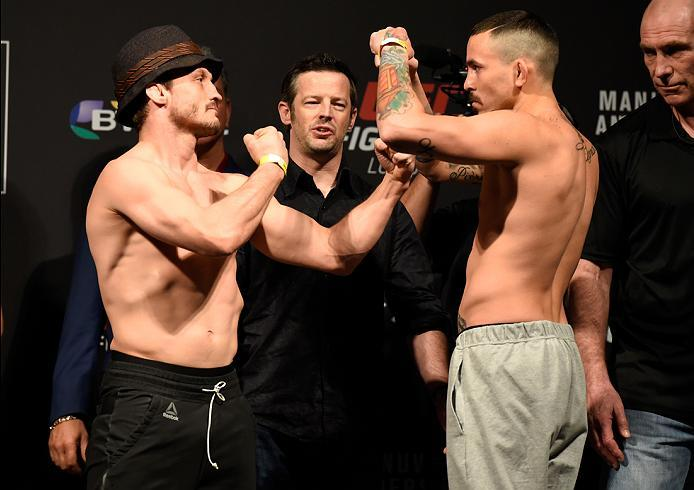 LONDON, ENGLAND - MARCH 17:  (L-R) Brad Pickett of England and Marlon Vera of Ecuador face off during the UFC Fight Night weigh-in at The O2 arena on March 17, 2017 in London, England. (Photo by Josh Hedges/Zuffa LLC/Zuffa LLC via Getty Images)