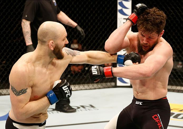 ZAGREB, CROATIA - APRIL 10:   (L-R) Zak Cummings punches Nicolas Dalby in their welterweight bout during the UFC Fight Night event at the Arena Zagreb on April 10, 2016 in Zagreb, Croatia. (Photo by Srdjan Stevanovic/Zuffa LLC/Zuffa LLC via Getty Images)
