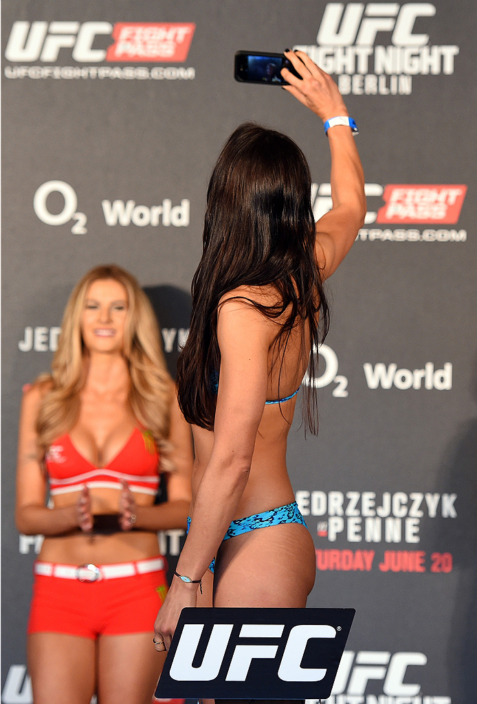 BERLIN, GERMANY - JUNE 19:   Jessica Penne takes a photo on the scale after making weight during the UFC Berlin weigh-in at the O2 World on June 19, 2015 in Berlin, Germany. (Photo by Josh Hedges/Zuffa LLC/Zuffa LLC via Getty Images)