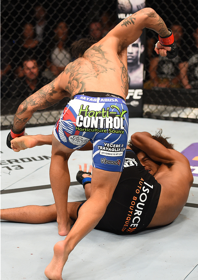 NEW ORLEANS, LA - JUNE 06:   Francisco Rivera (top) punches Alex Caceres in their bantamweight bout during the UFC event at the Smoothie King Center on June 6, 2015 in New Orleans, Louisiana. (Photo by Josh Hedges/Zuffa LLC/Zuffa LLC via Getty Images)