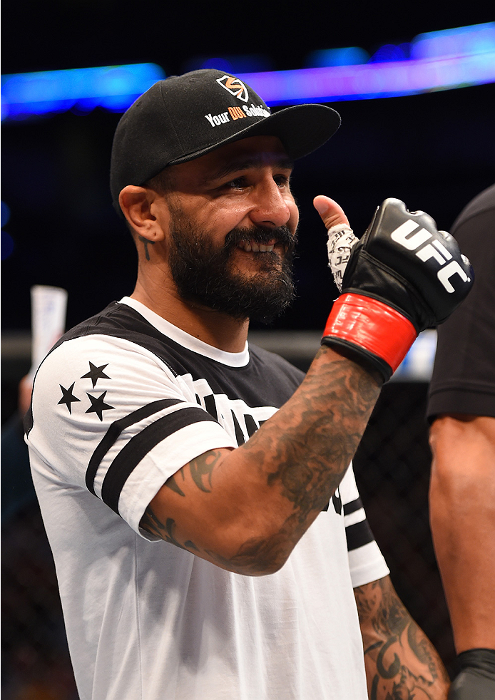 NEW ORLEANS, LA - JUNE 06:   Francisco Rivera celebrates his victory over Alex Caceres in their bantamweight bout during the UFC event at the Smoothie King Center on June 6, 2015 in New Orleans, Louisiana. (Photo by Josh Hedges/Zuffa LLC/Zuffa LLC via Get