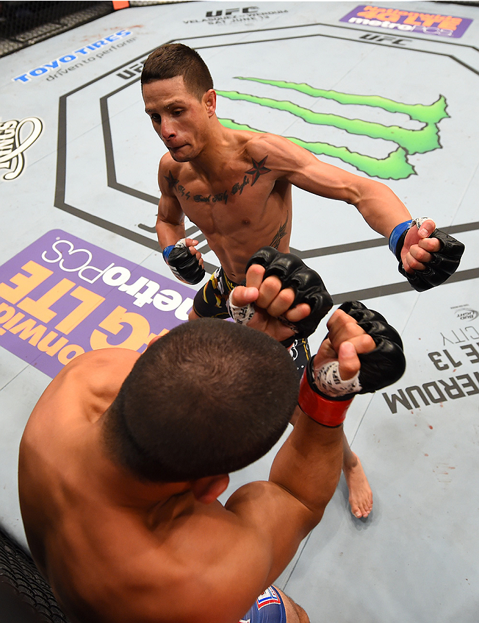 NEW ORLEANS, LA - JUNE 06:   Anthony Birchak punches Joe Soto in their bantamweight bout during the UFC event at the Smoothie King Center on June 6, 2015 in New Orleans, Louisiana. (Photo by Josh Hedges/Zuffa LLC/Zuffa LLC via Getty Images)