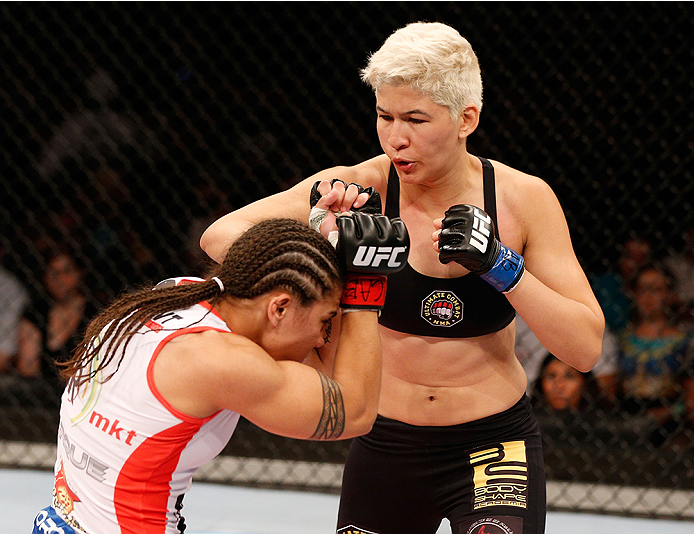 BRASILIA, BRAZIL - SEPTEMBER 13:  (R-L) Larissa Pacheco of Brazil punches Jessica Andrade of Brazil in their women's bantamweight bout during the UFC Fight Night event inside Nilson Nelson Gymnasium on September 13, 2014 in Brasilia, Brazil.  (Photo by Jo