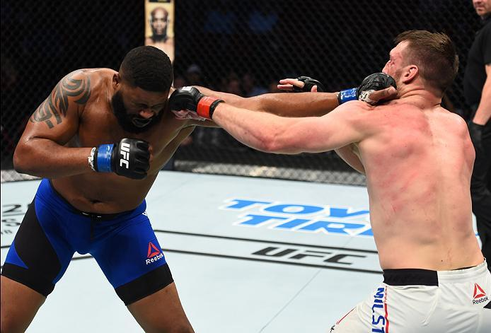 HOUSTON, TX - FEBRUARY 04:  (L-R) Curtis Blaydes punches Adam Milstead in their heavyweight bout during the UFC Fight Night event at the Toyota Center on February 4, 2017 in Houston, Texas. (Photo by Jeff Bottari/Zuffa LLC/Zuffa LLC via Getty Images)