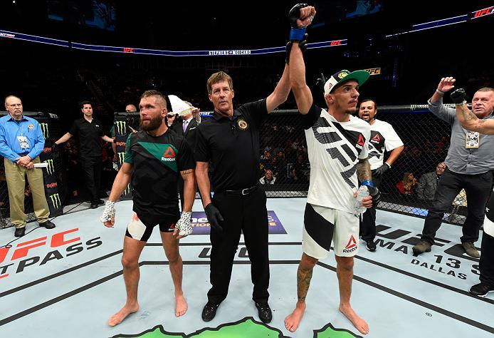 KANSAS CITY, MO - APRIL 15:  (R-L) Renato Moicano of Brazil celebrates his victory over Jeremy Stephens in their featherweight fight during the UFC Fight Night event at Sprint Center on April 15, 2017 in Kansas City, Missouri. (Photo by Josh Hedges/Zuffa