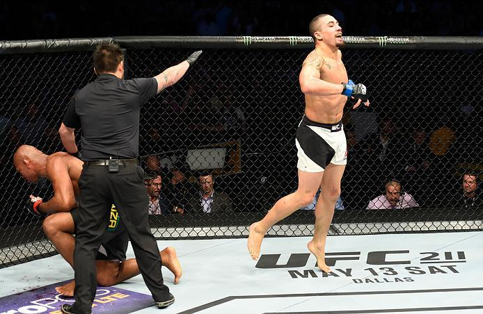 KANSAS CITY, MO - APRIL 15:  (R-L) Robert Whittaker of New Zealand celebrates his TKO victory over Jacare Souza of Brazil in their middleweight fight during the UFC Fight Night event at Sprint Center on April 15, 2017 in Kansas City, Missouri. (Photo by J