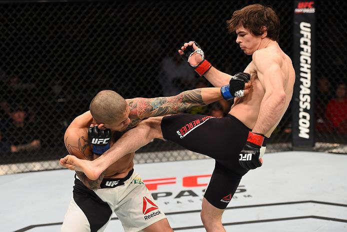 NEWARK, NJ - JANUARY 30:  (R-L) Olivier Aubin-Mercier kicks Diego Ferreira in their lightweight bout during the UFC Fight Night event at the Prudential Center on January 30, 2016 in Newark, New Jersey. (Photo by Josh Hedges/Zuffa LLC/Zuffa LLC via Getty I