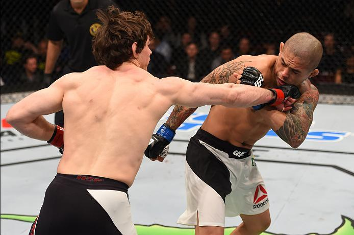 NEWARK, NJ - JANUARY 30:  (L-R) Olivier Aubin-Mercier punches Diego Ferreira in their lightweight bout during the UFC Fight Night event at the Prudential Center on January 30, 2016 in Newark, New Jersey. (Photo by Josh Hedges/Zuffa LLC/Zuffa LLC via Getty