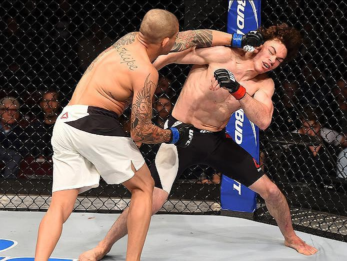 NEWARK, NJ - JANUARY 30:   (L-R) Diego Ferreira punches Olivier Aubin-Mercier in their lightweight bout during the UFC Fight Night event at the Prudential Center on January 30, 2016 in Newark, New Jersey. (Photo by Josh Hedges/Zuffa LLC/Zuffa LLC via Gett