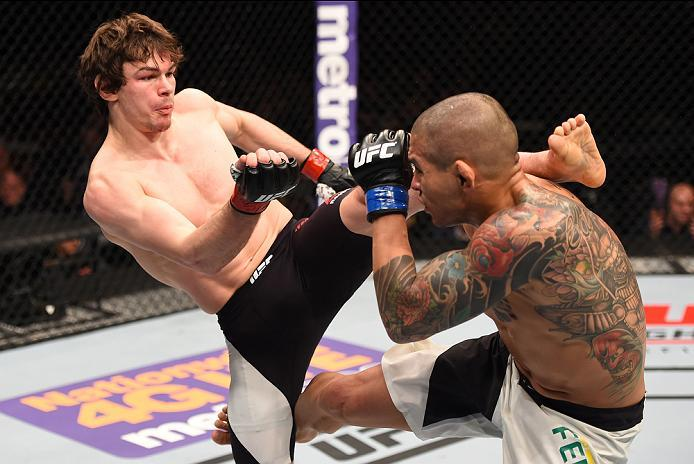NEWARK, NJ - JANUARY 30:  (L-R) Olivier Aubin-Mercier kicks Diego Ferreira in their lightweight bout during the UFC Fight Night event at the Prudential Center on January 30, 2016 in Newark, New Jersey. (Photo by Josh Hedges/Zuffa LLC/Zuffa LLC via Getty I