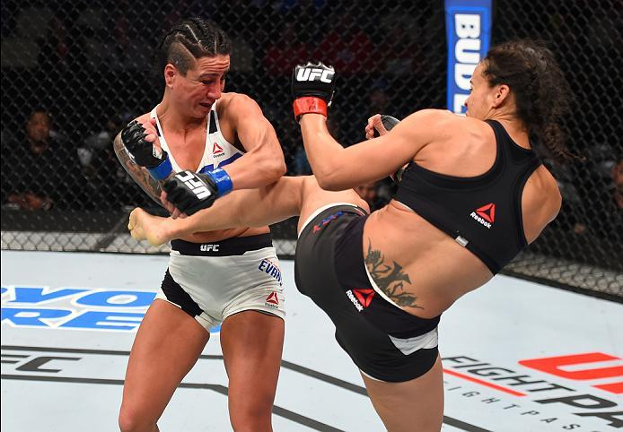 PITTSBURGH, PA - FEBRUARY 21:  (R-L) Marion Reneau kicks Ashlee Evans-Smith in their women's bantamweight bout during the UFC Fight Night event at Consol Energy Center on February 21, 2016 in Pittsburgh, Pennsylvania. (Photo by Jeff Bottari/Zuffa LLC/Zuff