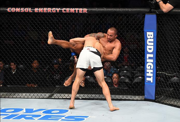 PITTSBURGH, PA - FEBRUARY 21:  (L-R) Nathan Coy takes down Jonavin Webb in their welterweight bout during the UFC Fight Night event at Consol Energy Center on February 21, 2016 in Pittsburgh, Pennsylvania. (Photo by Jeff Bottari/Zuffa LLC/Zuffa LLC via Ge