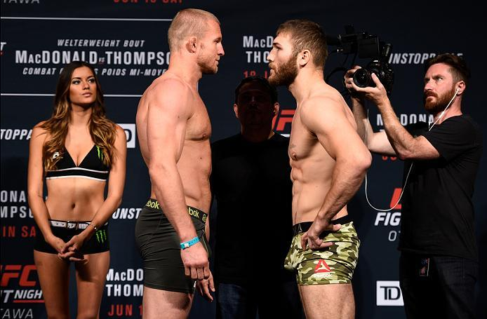 OTTAWA, ON - JUNE 17:  (L-R) Opponents Misha Cirkunov of Latvia and Ion Cutelaba of the Republic of Moldova face off during the UFC Fight Night Weigh-in inside the Arena at TD Place on June 17, 2016 in Ottawa, Ontario, Canada. (Photo by Jeff Bottari/Zuffa