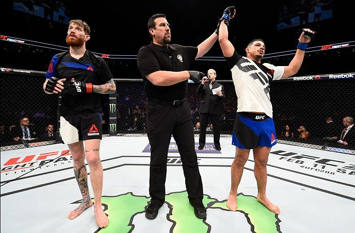 PHOENIX, AZ - JANUARY 15:  (R-L) Drakkar Klose celebrates his victory over Devin Powell in their lightweight bout during the UFC Fight Night event inside Talking Stick Resort Arena on January 15, 2017 in Phoenix, Arizona. (Photo by Jeff Bottari/Zuffa LLC/