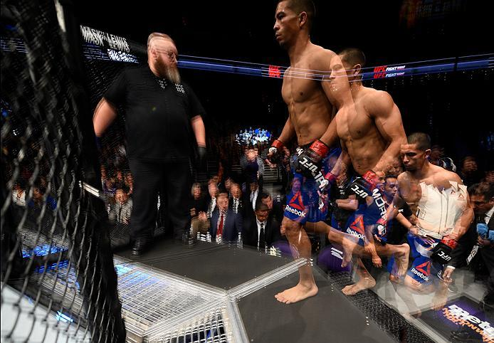 PHOENIX, AZ - JANUARY 15:  (EDITORS NOTE: This image has been created using multiple exposure in camera) John Moraga enters the Octagon before facing Sergio Pettis in their flyweight bout during the UFC Fight Night event inside Talking Stick Resort Arena