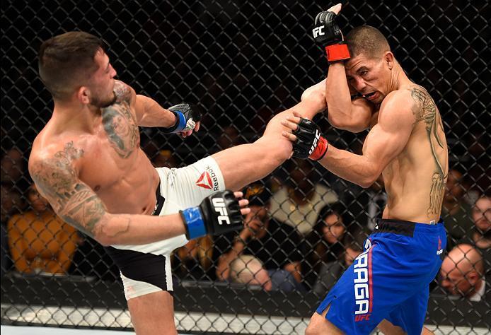 PHOENIX, AZ - JANUARY 15:  (L-R) Sergio Pettis kicks John Moraga in their flyweight bout during the UFC Fight Night event inside Talking Stick Resort Arena on January 15, 2017 in Phoenix, Arizona. (Photo by Jeff Bottari/Zuffa LLC/Zuffa LLC via Getty Image