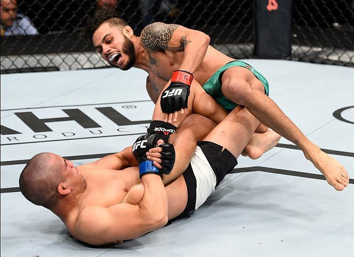 MEXICO CITY, MEXICO - NOVEMBER 05:  (L-R) Joe Soto of the United States submits Marco Beltran of Mexico in their catchweight bout during the UFC Fight Night event at Arena Ciudad de Mexico on November 5, 2016 in Mexico City, Mexico. (Photo by Jeff Bottari