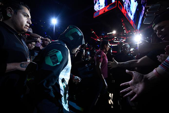 MEXICO CITY, MEXICO - NOVEMBER 05:  Erik Perez of Mexico prepares to enter the Octagon before facing Felipe Arantes of Brazil in their bantamweight bout during the UFC Fight Night event at Arena Ciudad de Mexico on November 5, 2016 in Mexico City, Mexico.