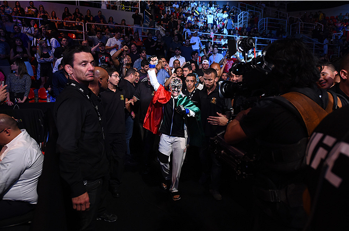 RIO DE JANEIRO, BRAZIL - AUGUST 01:  Jessica Aguilar of the United States prepares to enter the Octagon before facing Claudia Gadelha of Brazil in their women's strawweight bout during the UFC 190 event inside HSBC Arena on August 1, 2015 in Rio de Janeir