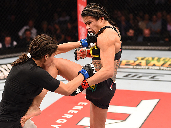 RIO DE JANEIRO, BRAZIL - AUGUST 01:  (R-L) Claudia Gadelha of Brazil kicks Jessica Aguilar of the United States in their women's strawweight bout during the UFC 190 event inside HSBC Arena on August 1, 2015 in Rio de Janeiro, Brazil.  (Photo by Josh Hedge
