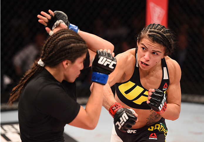 RIO DE JANEIRO, BRAZIL - AUGUST 01:  (R-L) Claudia Gadelha of Brazil punches Jessica Aguilar of the United States in their women's strawweight bout during the UFC 190 event inside HSBC Arena on August 1, 2015 in Rio de Janeiro, Brazil.  (Photo by Josh Hed