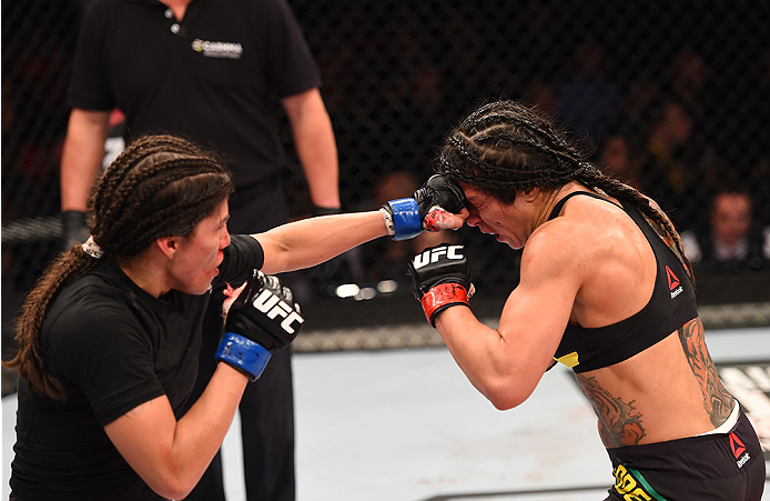 RIO DE JANEIRO, BRAZIL - AUGUST 01:  (L-R) Jessica Aguilar of the United States punches Claudia Gadelha of Brazil in their women's strawweight bout during the UFC 190 event inside HSBC Arena on August 1, 2015 in Rio de Janeiro, Brazil.  (Photo by Josh Hed