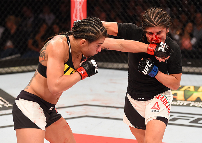 RIO DE JANEIRO, BRAZIL - AUGUST 01:  (L-R) Claudia Gadelha of Brazil punches Jessica Aguilar of the United States in their women's strawweight bout during the UFC 190 event inside HSBC Arena on August 1, 2015 in Rio de Janeiro, Brazil.  (Photo by Josh Hed