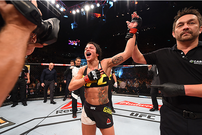 RIO DE JANEIRO, BRAZIL - AUGUST 01:  Claudia Gadelha of Brazil celebrates her victory over Jessica Aguilar of the United States in their women's strawweight bout during the UFC 190 event inside HSBC Arena on August 1, 2015 in Rio de Janeiro, Brazil.  (Pho