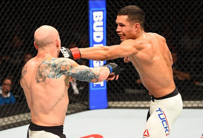 ROTTERDAM, NETHERLANDS - MAY 08:  (R-L) Jon Tuck punches Josh Emmett in their lightweight bout during the UFC Fight Night event at Ahoy Rotterdam on May 8, 2016 in Rotterdam, Netherlands. (Photo by Josh Hedges/Zuffa LLC/Zuffa LLC via Getty Images)