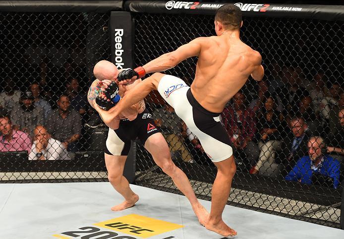 ROTTERDAM, NETHERLANDS - MAY 08:  (R-L) Jon Tuck kicks Josh Emmett in their lightweight bout during the UFC Fight Night event at Ahoy Rotterdam on May 8, 2016 in Rotterdam, Netherlands. (Photo by Josh Hedges/Zuffa LLC/Zuffa LLC via Getty Images)