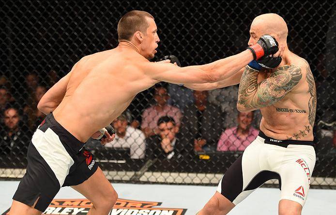 ROTTERDAM, NETHERLANDS - MAY 08:  (L-R) Magnus Cedenblad punches Garreth McLellan in their middleweight bout during the UFC Fight Night event at Ahoy Rotterdam on May 8, 2016 in Rotterdam, Netherlands. (Photo by Josh Hedges/Zuffa LLC/Zuffa LLC via Getty I