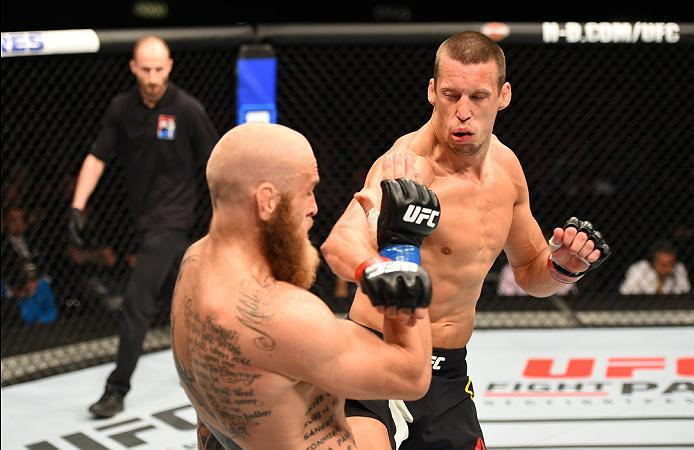 ROTTERDAM, NETHERLANDS - MAY 08:  (R-L) Magnus Cedenblad punches Garreth McLellan in their middleweight bout during the UFC Fight Night event at Ahoy Rotterdam on May 8, 2016 in Rotterdam, Netherlands. (Photo by Josh Hedges/Zuffa LLC/Zuffa LLC via Getty I