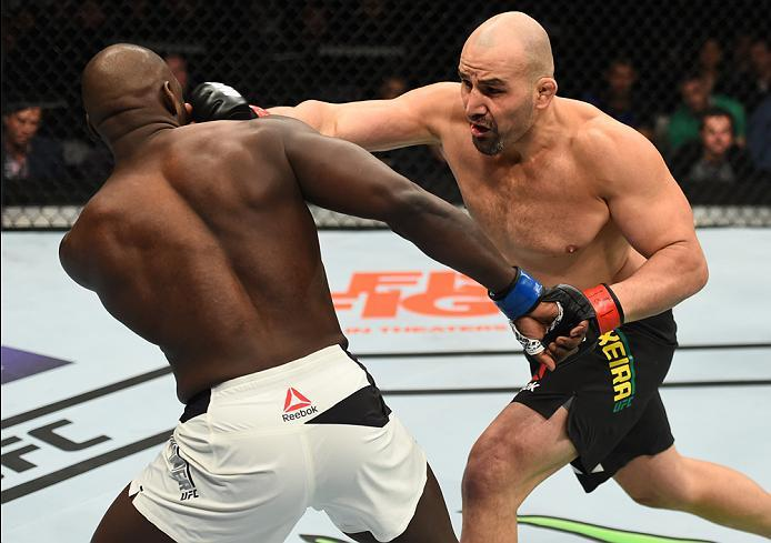 BROOKLYN, NEW YORK - FEBRUARY 11:  (R-L) Glover Teixeira of Brazil punches Jared Cannonier in their light heavyweight bout during the UFC 208 event inside Barclays Center on February 11, 2017 in Brooklyn, New York. (Photo by Jeff Bottari/Zuffa LLC/Zuffa L