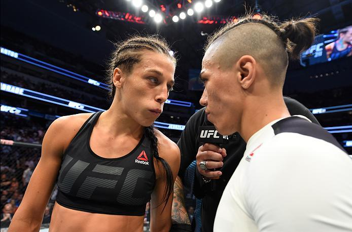 DALLAS, TX - MAY 13:  (L-R) Joanna Jedrzejczyk and Jessica Andrade face off in their UFC women's strawweight championship fight during the UFC 211 event at the American Airlines Center on May 13, 2017 in Dallas, Texas. (Photo by Josh Hedges/Zuffa LLC/Zuff