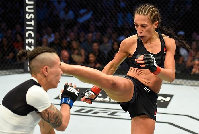 DALLAS, TX - MAY 13:  (R-L) Joanna Jedrzejczyk kicks Jessica Andrade in their UFC women's strawweight championship fight during the UFC 211 event at the American Airlines Center on May 13, 2017 in Dallas, Texas. (Photo by Josh Hedges/Zuffa LLC/Zuffa LLC v