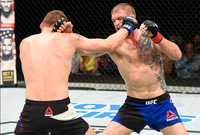 HIDALGO, TX - SEPTEMBER 17:   (L-R) Rick Glenn punches Evan Dunham in their lightweight bout during the UFC Fight Night event at State Farm Arena on September 17, 2016 in Hidalgo, Texas. (Photo by Josh Hedges/Zuffa LLC/Zuffa LLC via Getty Images)