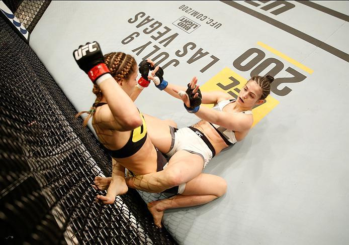 ZAGREB, CROATIA - APRIL 10:   Maryna Moroz (top) punches Cristina Stanciu in their strawweight bout during the UFC Fight Night event at the Arena Zagreb on April 10, 2016 in Zagreb, Croatia. (Photo by Srdjan Stevanovic/Zuffa LLC/Zuffa LLC via Getty Images
