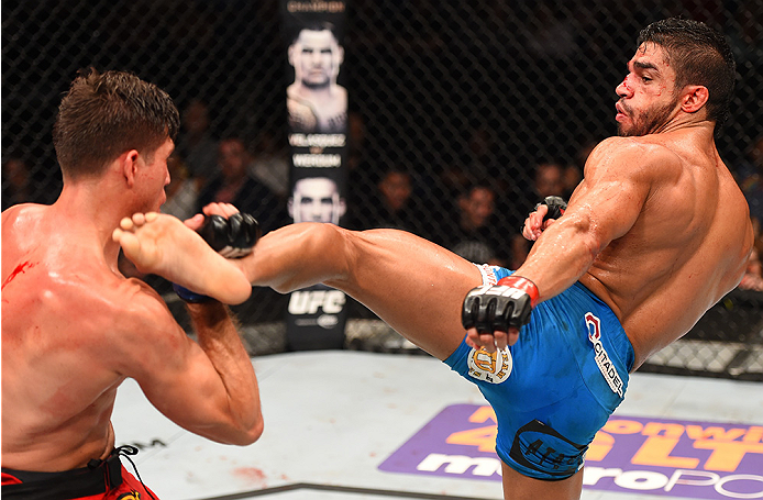 NEW ORLEANS, LA - JUNE 06:   (R-L) Thiago Tavares kicks Brian Ortega in their featherweight bout during the UFC event at the Smoothie King Center on June 6, 2015 in New Orleans, Louisiana. (Photo by Josh Hedges/Zuffa LLC/Zuffa LLC via Getty Images)