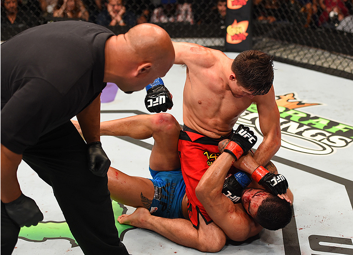 NEW ORLEANS, LA - JUNE 06:  Brian Ortega (top)punches Thiago Tavares in their featherweight bout during the UFC event at the Smoothie King Center on June 6, 2015 in New Orleans, Louisiana. (Photo by Josh Hedges/Zuffa LLC/Zuffa LLC via Getty Images)