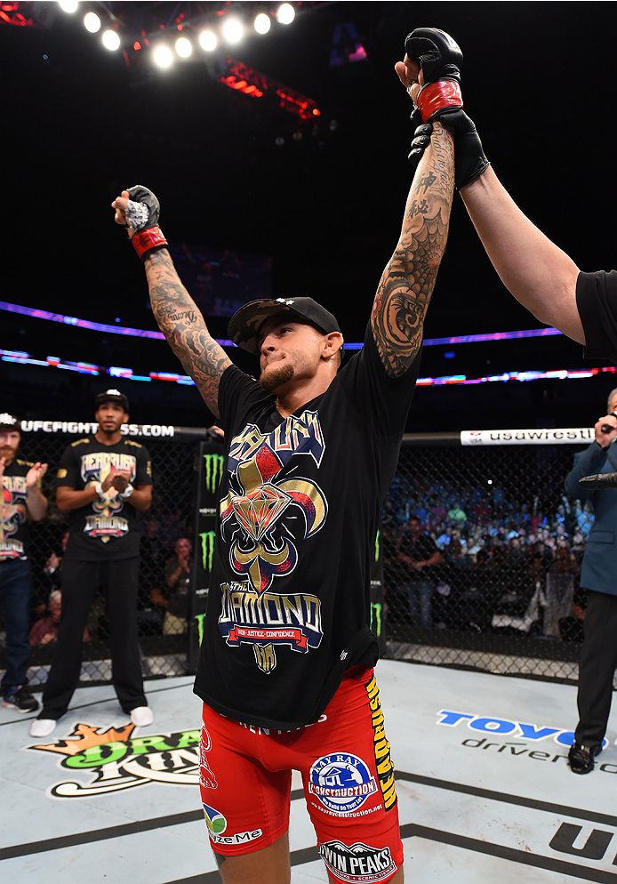NEW ORLEANS, LA - JUNE 06:  Dustin Poirier celebrates his victory over Yancy Medeiros in their lightweight bout during the UFC event at the Smoothie King Center on June 6, 2015 in New Orleans, Louisiana. (Photo by Josh Hedges/Zuffa LLC/Zuffa LLC via Getty