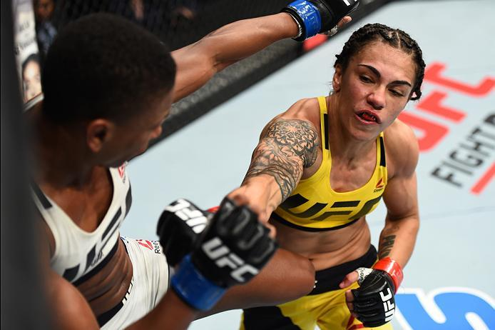 HOUSTON, TX - FEBRUARY 04:  (R-L) Jessica Andrade of Brazil punches Angela Hill in their women's strawweight bout during the UFC Fight Night event at the Toyota Center on February 4, 2017 in Houston, Texas. (Photo by Jeff Bottari/Zuffa LLC/Zuffa LLC via G