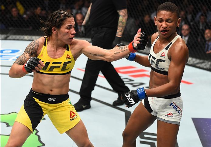 HOUSTON, TX - FEBRUARY 04:  (L-R) Jessica Andrade of Brazil punches Angela Hill in their women's strawweight bout during the UFC Fight Night event at the Toyota Center on February 4, 2017 in Houston, Texas. (Photo by Jeff Bottari/Zuffa LLC/Zuffa LLC via G
